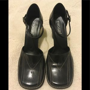 Two lips black heeled Mary Janes